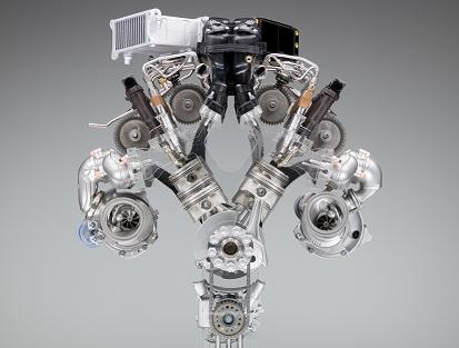 This shows the working bits of the new engine. Dual turbos, dual-VANOS, direct injection, on demand oil and water pumps all combine to create a very potent package. Image from BMW.